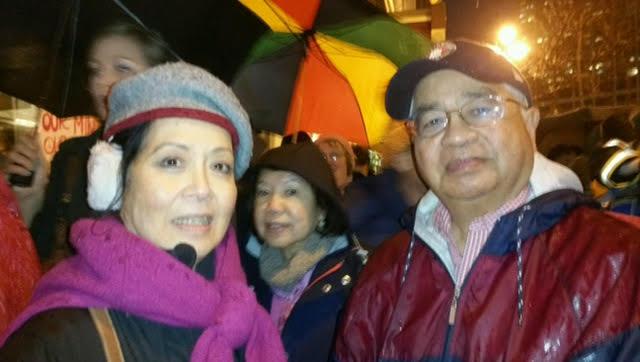 Susan Po Rufino, Mila and Ernie Llorente join surge for justice. (Photo courtesy Susan Po Rufino)