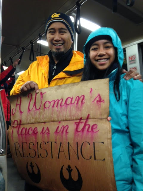 Feminist dad Carlos Cervantes encourages daughter Angel's nascent activism. (Photo by M. Z. Moreno)