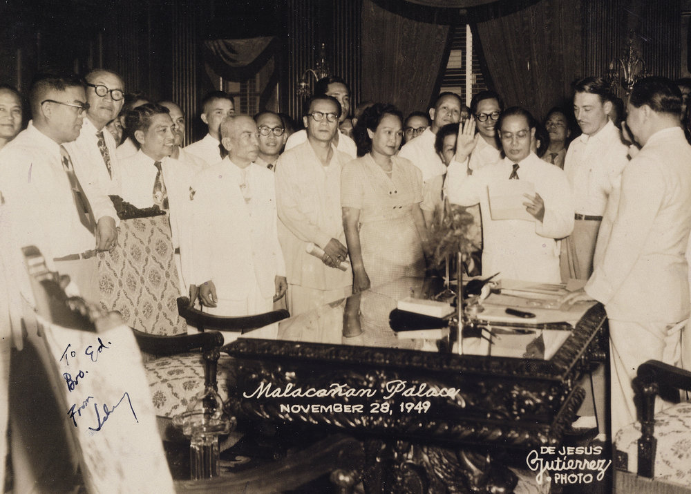 Juan Benitez sworn in as Philippine Veterans Board Chairman by President Elpidio Quirino, Malacañang Palace 1949. Standing beside Juan is Ed Ramsey (Photo courtesy of de Jesus Gutierrez Photo)