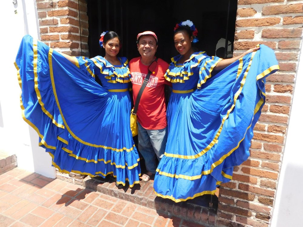 Our tour group was met by these ladies at the Atarazanna Restaurant in Santo Domingo, Dominican Republic. (Photo is courtesy of Rey E. de la Cruz, photo editing by Ivan Kevin Castro)