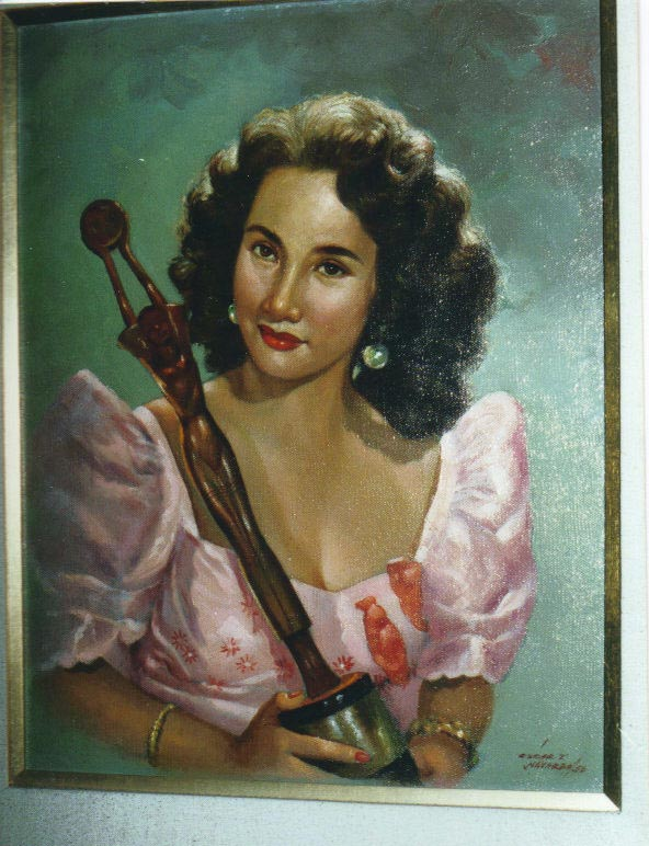 A painting of Carol Varga in a Ruben Panis terno holding her FAMAS statuette for her supporting role inGuapo (Handsome). (Photo is courtesy of Carol Varga)