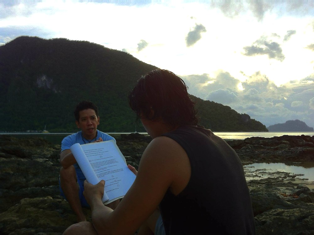 All in a day's work, reading the  Baybayin  screenplay with a grand Palawan scape as backdrop (Photo by Don Gordon Bell)