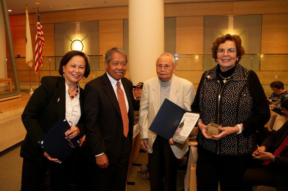 Left to Right: Cecilia Gaerlan, Lt. General Soriano, who presented Proculo Bualat, 92nd Coast Artillery, with a Certificate of Recognition, and Mrs. Connie McHugh. (Note: Mr. Bualat recently passed away, a few months after receiving this certificate.) (Photo courtesy of Bataan Legacy Historical Society)
