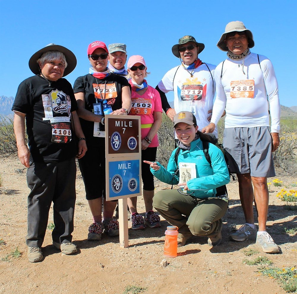 The author (left) and family members of Team Garibato of Seattle, Washington pose for a photo at Mile 7.(Photo by Jon Melegrito)