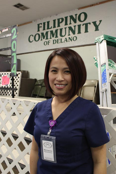 Mimi Ignacio, a nurse at the Filipino Community Center in Delano, California. She worked in the fields as a teenager and now serves the elder Filipinos in the area that go to the Center, a historic location in the city. (Photo by Dorian Merina)