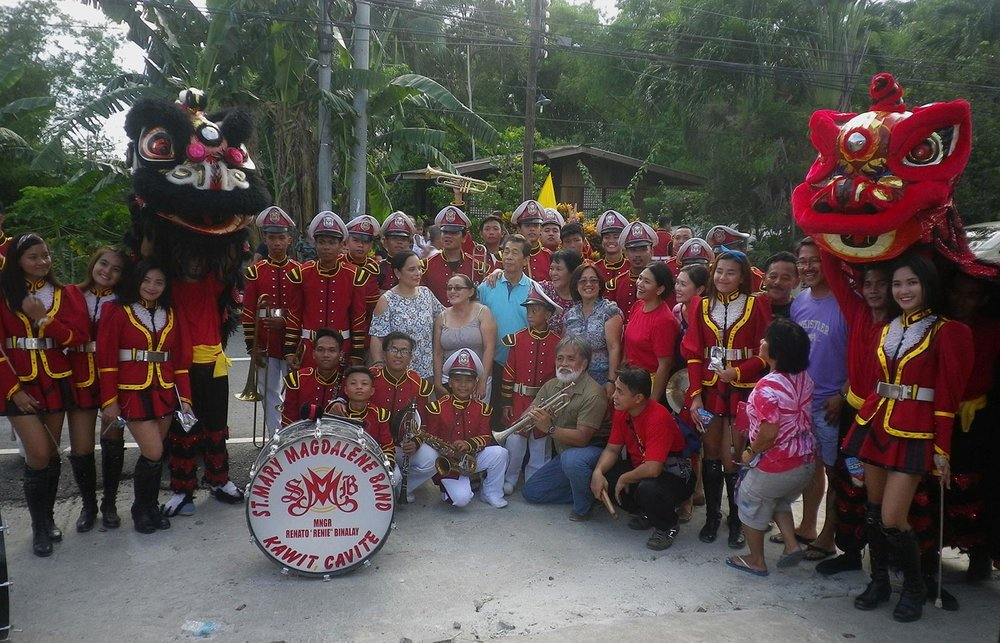 Two highly acclaimed performing groups were 'imported' by the organizers to liven up the June 1 Cupang fiesta--the St. Mary Magdalene marching band of Kawit, Cavite, and a Wushu Lion Dance team from Quezon City headed by Artemio Montes and Mary Ann Jasa -- shown here with members of the Angkan nina Anong at Rosa. (Photo by Ed Maranan)