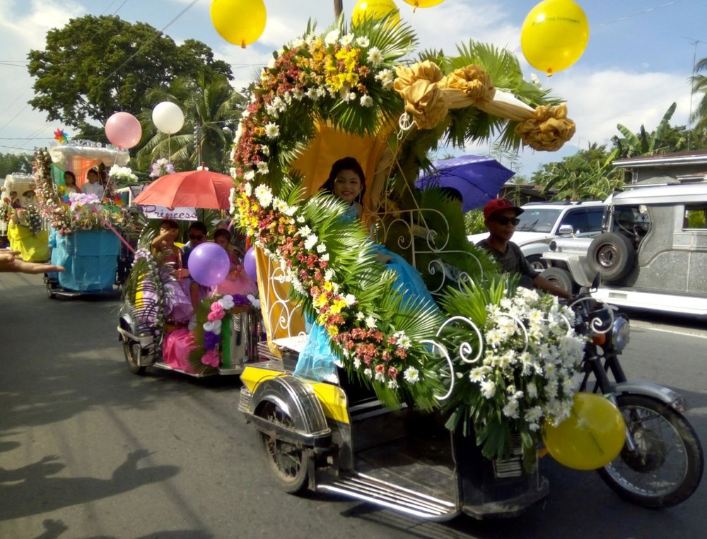 In the afternoon, the main feature was the parade of lavishly decorated tricycles carrying the little princes and princesses of the barrio, led by the marching band. (Photo by Ed Maranan)