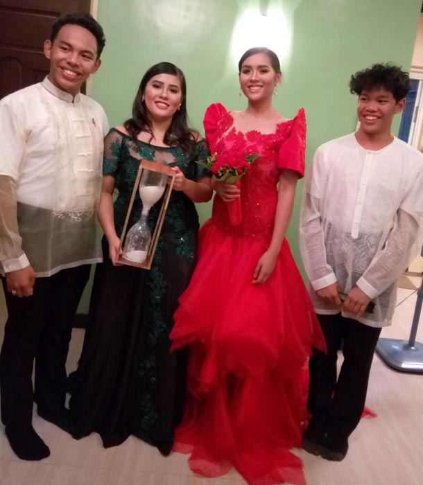 In the evening's Santacruzan or procession of the Holy Cross, sisters Patricia and Sofia San Diego (2nd and 3rd from left) reigned as Reyna ng mga Propetas and Diwata ng Kagandahan respectively, with their cousins Pedro Fernando Maranan (left) and Lorenzo Maranan (right) as their escorts. (Photo by Ed Maranan).