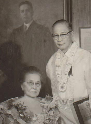 PWU's founders Dean Conrado and Francisca Tirona Benitez by a portrait of Chief Justice Jose Abad Santos (PWU's first chairman of the Board of Trustees)