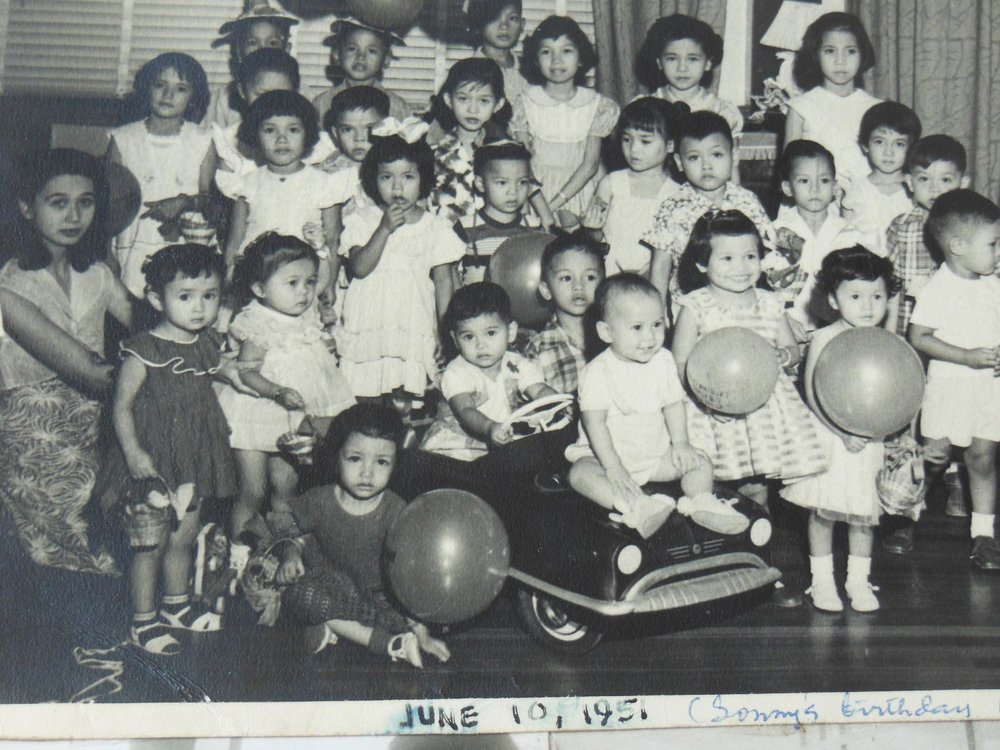 My birthday party, age two. Lolo gave me a big red push-pedal fire truck