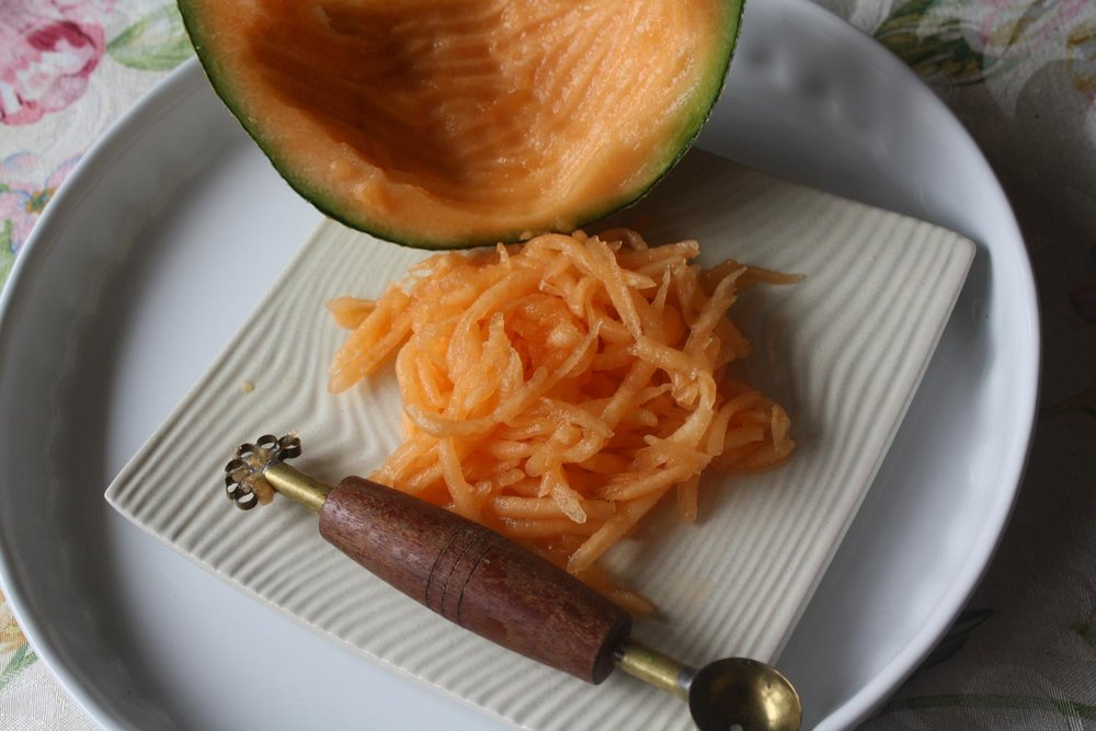 Shredded cantaloupe strips using a grater (Photo by Elizabeth Ann Quirino)