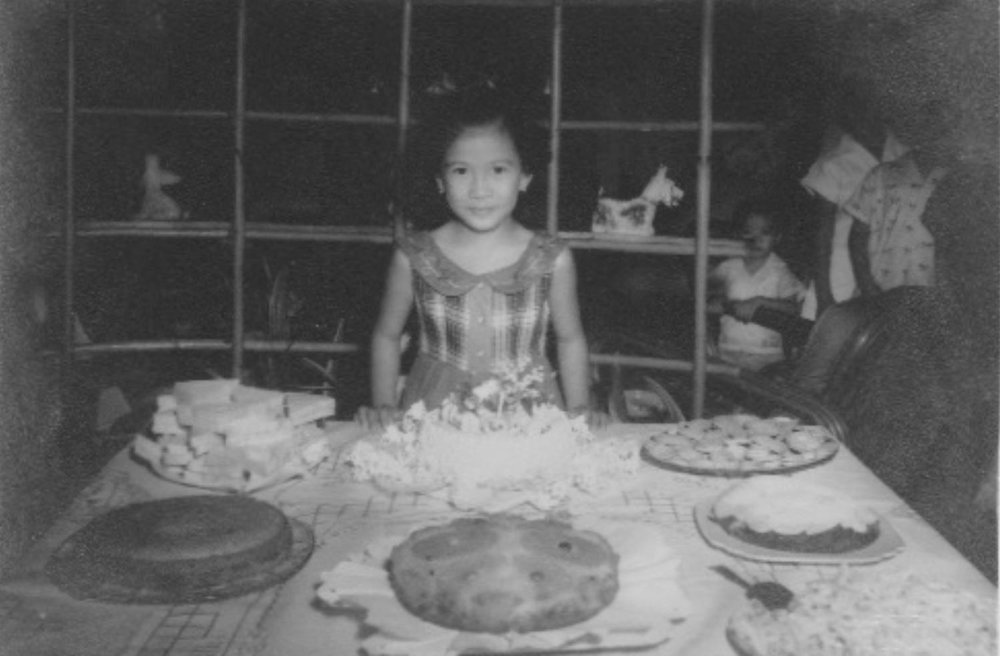 Author at her 6th birthday party with vault behind the bamboo shelving (Photo courtesy of Lilia V. Villanueva)