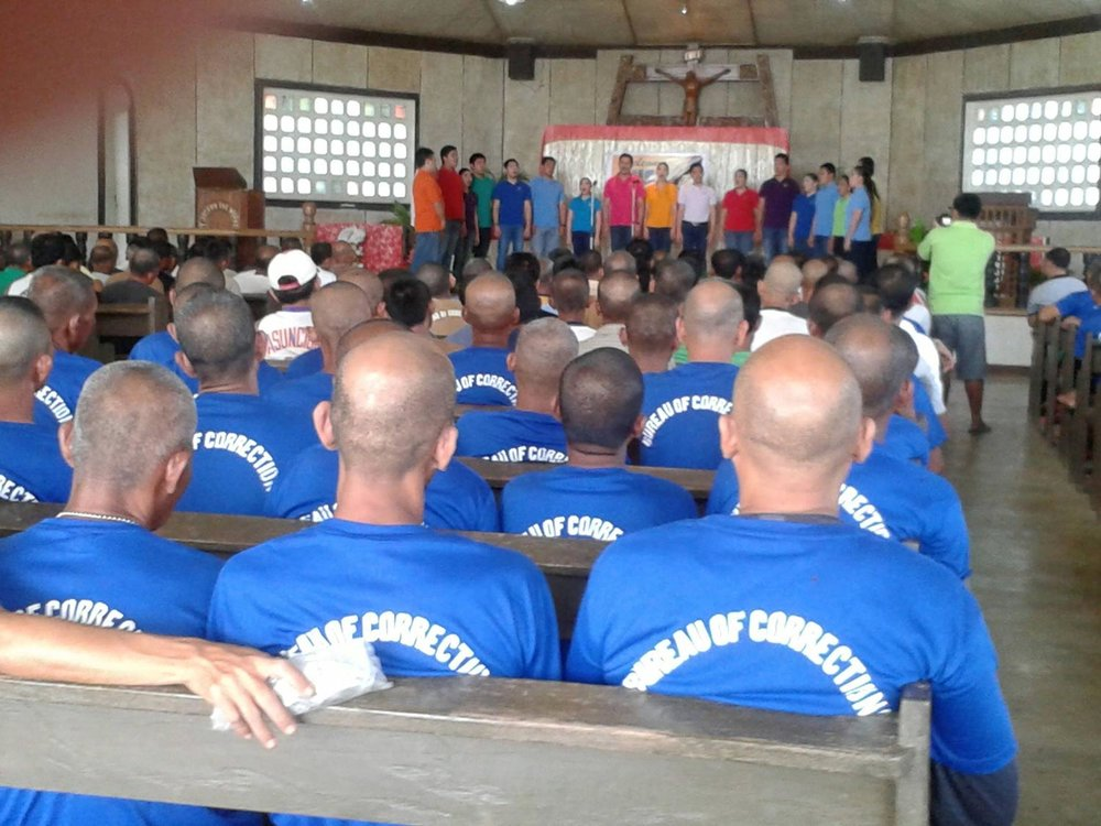 Singing for inmates at the Iwahig Prison and Penal farm in Palawan. (Photo courtesy of the Philippine Madrigal Singers)