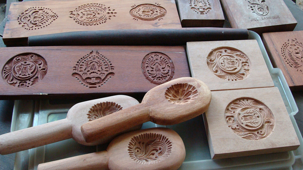 Pan de San Nicolas antique wooden cookie molds are hand carved from mahogany, yakal and molave.(photo previously published on Positively Filipino - Culinary Day Tours by Elizabeth Ann Quirino)