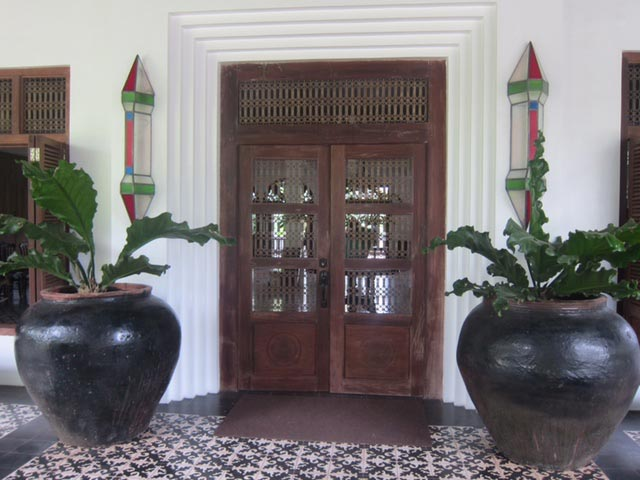 These beautiful, latticed wooden doors open to a ballroom. It was not yet finished when we ventured inside.