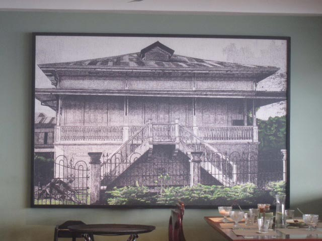 An enlarged photo of a typical Balay Dako (Big House) hangs on the restaurant's wall.