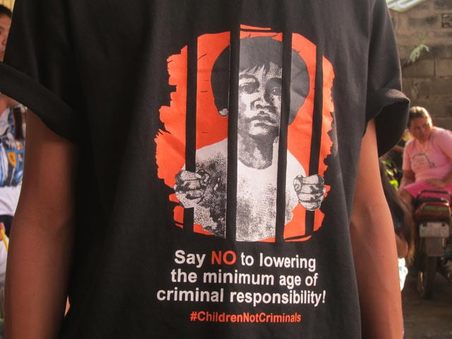 Child advocates are opposed to the government's intention of lowering the minimum age of criminal responsibility (as shown in this T-shirt worn by one of our scholars) from 15 to 9 years old. They say this would make children targets in President Duterte's deadly war on drugs.