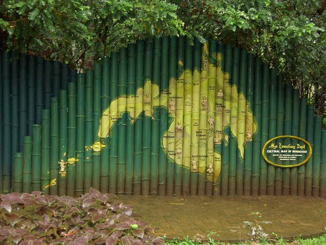 A carved bamboo fence shows the cultural map of Mindanao at Eden Nature Park.