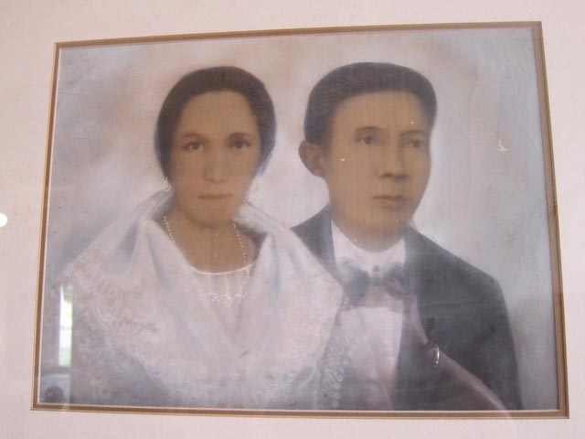 Underneath this photo reads: The wedding picture of Enrica Alunan and Efigenio Lizares. They were married on February 10, 1872. This union is marked by the construction of this house.