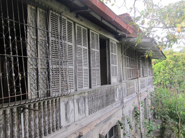 The side of Balay ni Tana Dicang. To protect the house from the heat, Venetian style window shutters let the air in and keep it in shade.