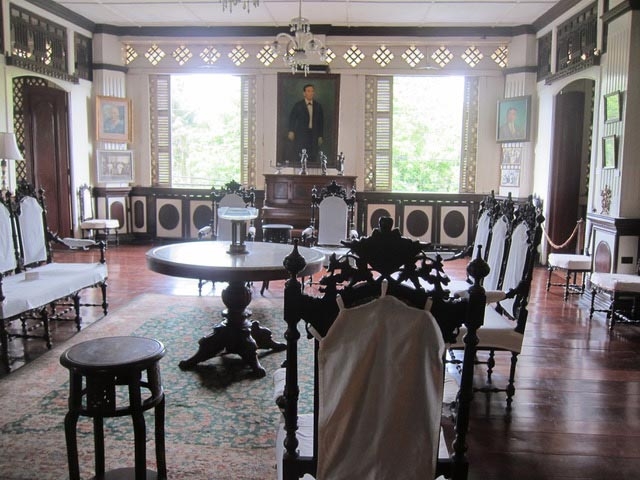 The living and dining rooms were the biggest areas in the house. Persian style windows kept the rain out while allowing the light in through translucent  capiz  shell panes.