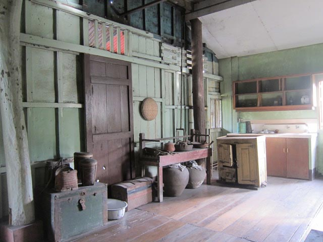 The kitchen at Balay ni Tana Dicang. The low, beige cabinet with open doors was used to store food, like a refrigerator.  Bagoong  (Filipino fish sauce) was stored in the big, round clay pots.