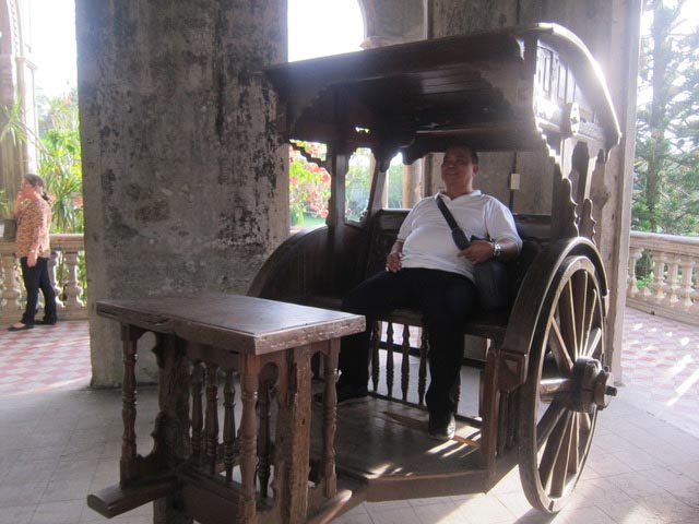 The wooden  karitela  was not part of the mansion but added as an attraction for tourists, like the man seated inside.
