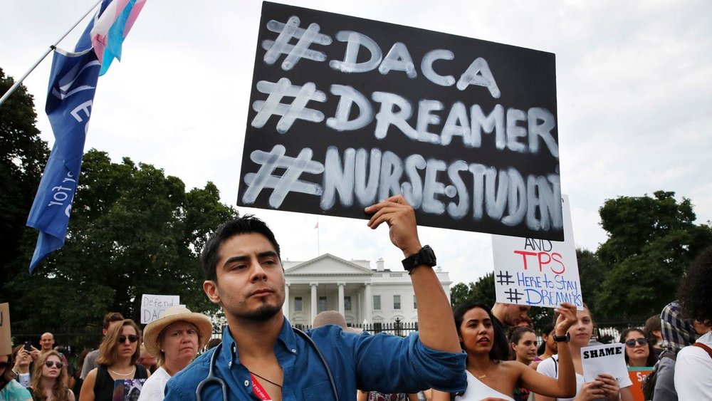 DACA supporters outside the White House (Photo by Jacquelyn Martin/Associated Press)
