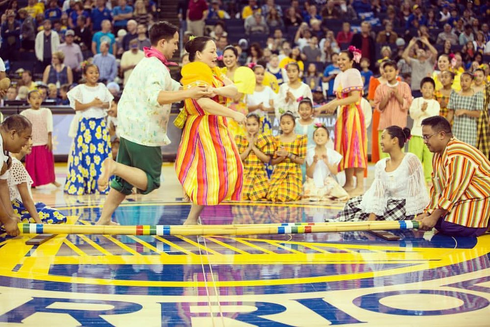 LIKHA Pilipino Folk Ensemble performing tinikling during a Warriors Game. (Photo by pc@amazestudios)