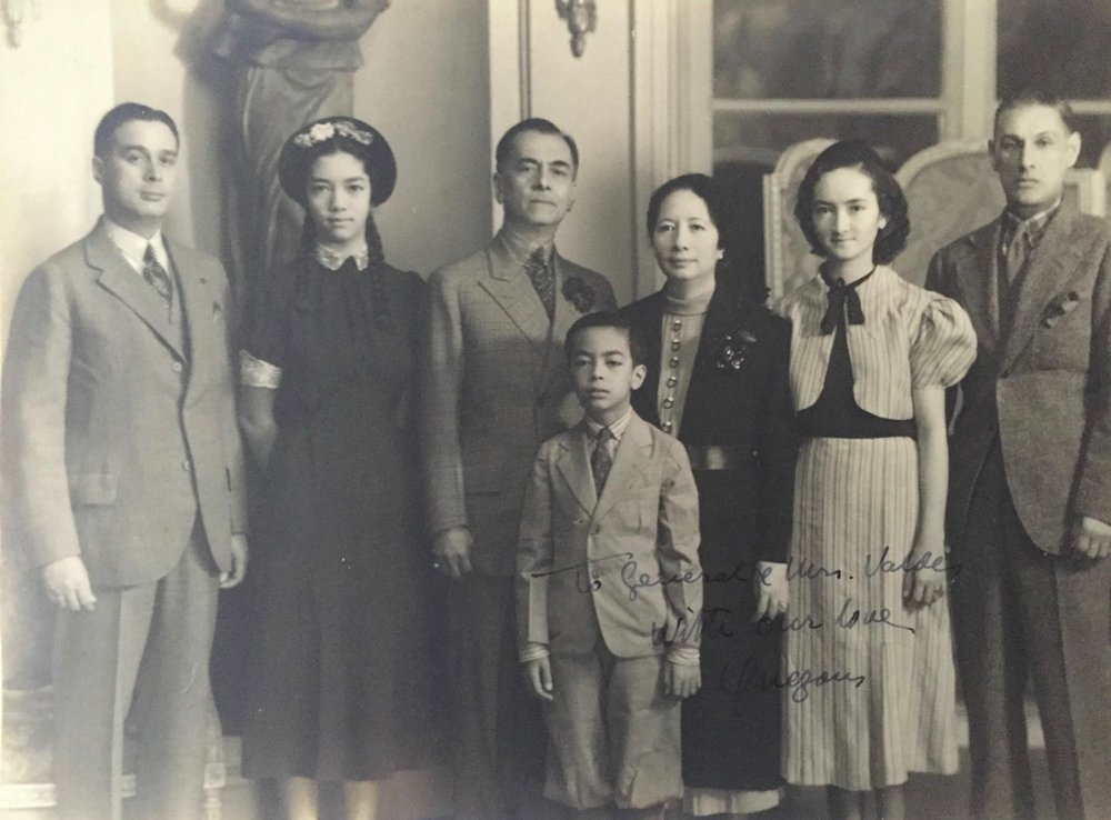 Major General Basilio Valdes (left) with the Quezon family.