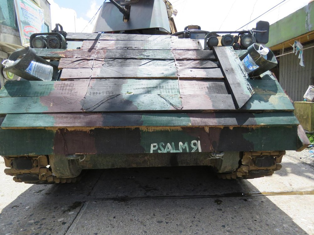 An armored troop carrier with PSALM 91 scrawled in front (Photo by Criselda Yabes)