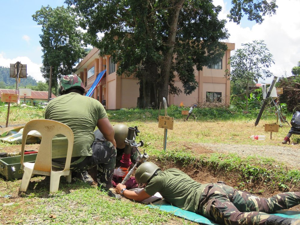 Soldiers launching shells from their mortar (Photo by Criselda Yabes)