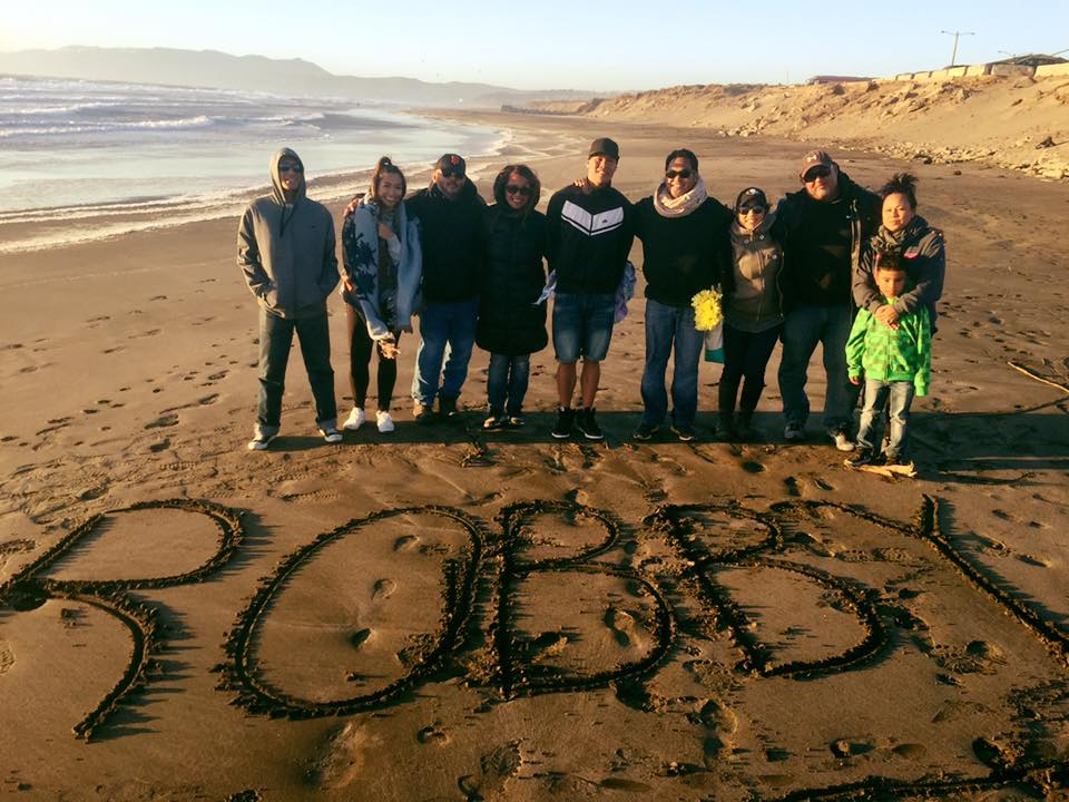 Friends and family remembering Robby at Ocean Beach on the anniversary of his death (Photo courtesy of Pati Poblete)