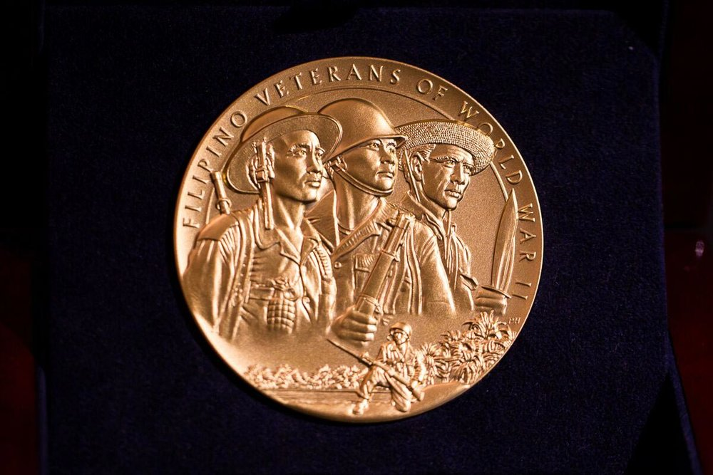 The Congressional Gold Medal will be displayed in the Smithsonian's National Museum of American History. Bronze replicas of the medal were individually awarded to living veterans and next of kin. (Photo by Les Talusan/FilVetREP)