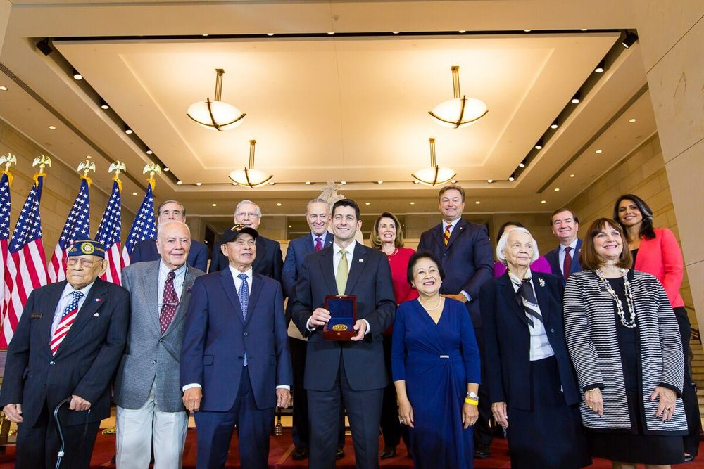 House Speaker Paul Ryan (center) presents the Congressional Gold Medal at a ceremony in Capitol Hill attended by congressional leaders, living veterans and family members. (Photo by Les Talusan/FilVetREP)