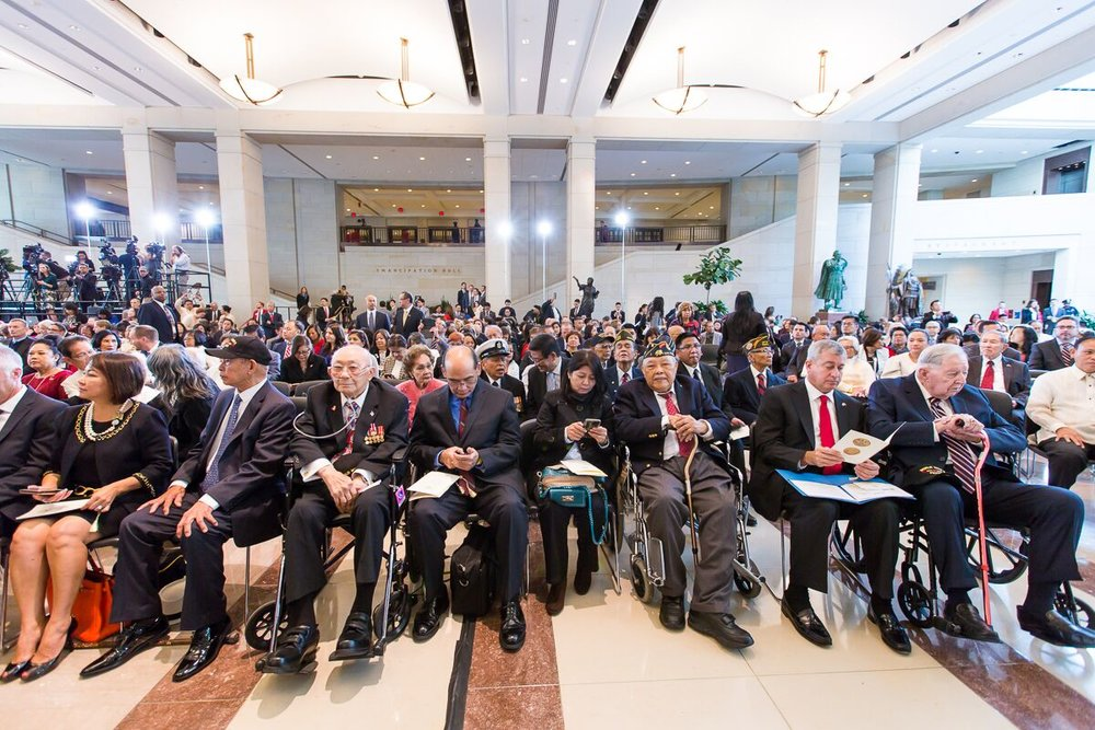 Living veterans and their families gather in Emancipation Hall for the Congressional Ceremony honoring Filipino World War II veterans. (Photo by Les Talusan/FilVetREP)
