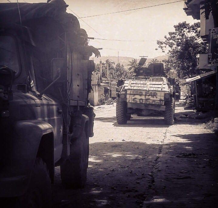 Military vehicles making way through the battered city (Photo by Bal)