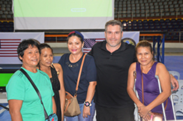Director Nick Spark poses with a group of people with disability who were special guests at the Tacloban screening (Photo courtesy of Alex Ago)
