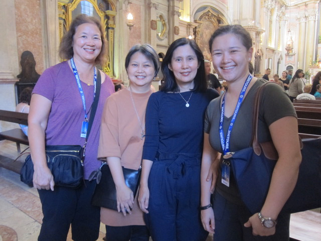 Fellow pilgrims from Manila:  Celine (left) and Joysie (right) welcome sisters Lisa Bengson (second from left) and Gina Lim (beside her) to our group in Lisbon.