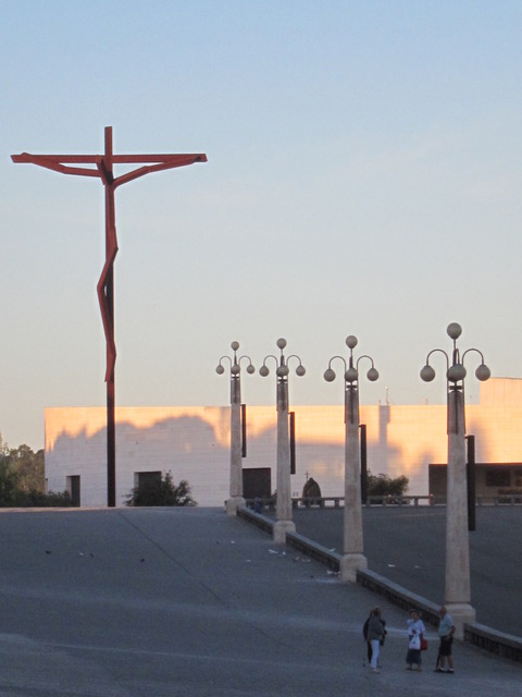 A giant cross stands in the plaza.