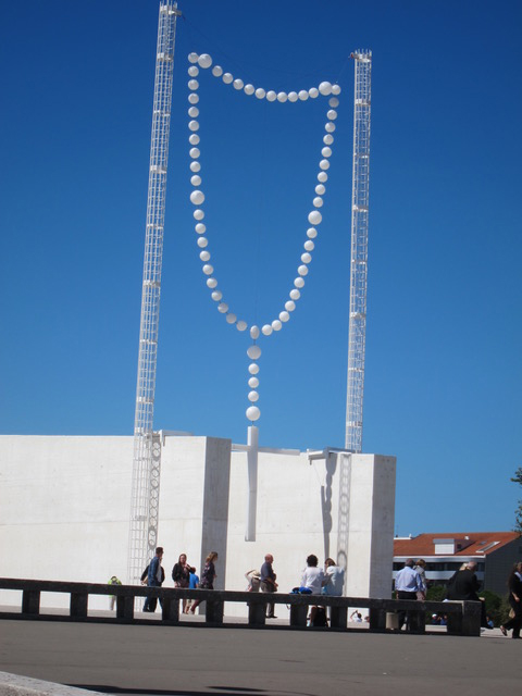 A giant rosary in the plaza reminds pilgrims to pray daily.