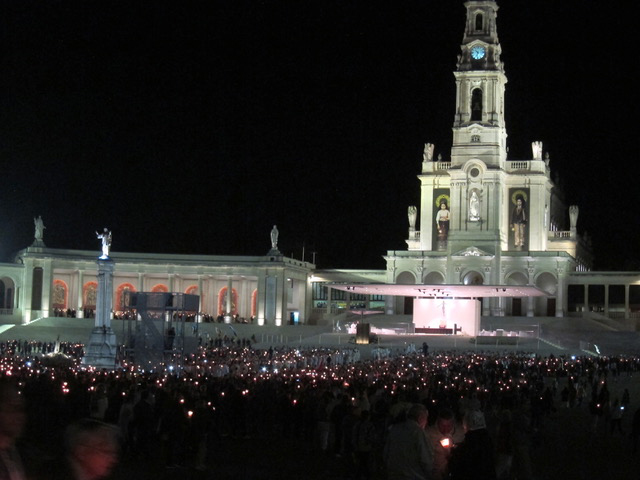 An emotional evening in Fatima.  We participated in praying the Rosary where a decade was recited in Tagalog (an acknowledgement to the thousands of Filipino pilgrims who come every year). And then the candlelight procession started with the statue of the Blessed Virgin, sitting on a bed of white flowers, touring the plaza so everyone could get a chance to see her. The procession is repeated during the day as well.