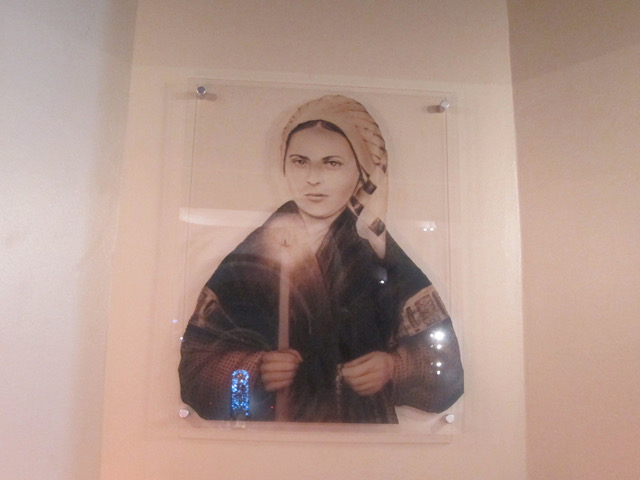 Bernadette's photo in the museum.  The town of Lourdes is nestled within the Pyrenees Mountains, and it is where Our Lady appeared to Bernadette Soubirous in 1858 near the grotto of Massabielle. She was the eldest of nine children; sickly as a child and she contracted tuberculosis of the bone in her right knee in later life. Despite initial skepticism from the Catholic Church, Bernadette was canonized on December 8, 1933.