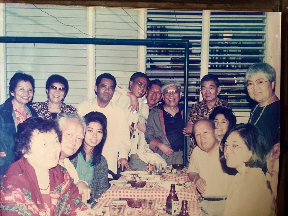 At a Midweek magazine Christmas party at our home. Seated L-R: Emerenciana Arcellana, Franz Arcellana, Lourdes Brillantes, Bienvenido Santos, and Tezza Parel. Standing L-R: Gloria Licad Lanot, Narita Manuel Gonzalez, Joe Quirino, Gregorio Brillantes, Nick Joaquin, NVM Gonzalez, Serafin Lanot, and Doreen Fernandez