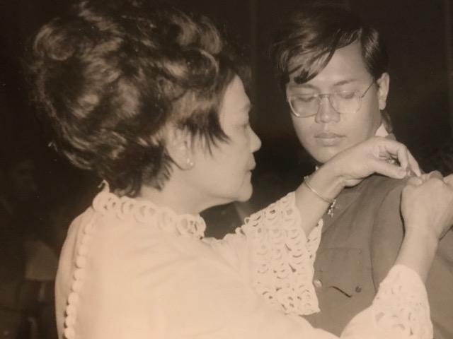 My mother, Felicidad, pinning my 2nd Lt. bars, 1969