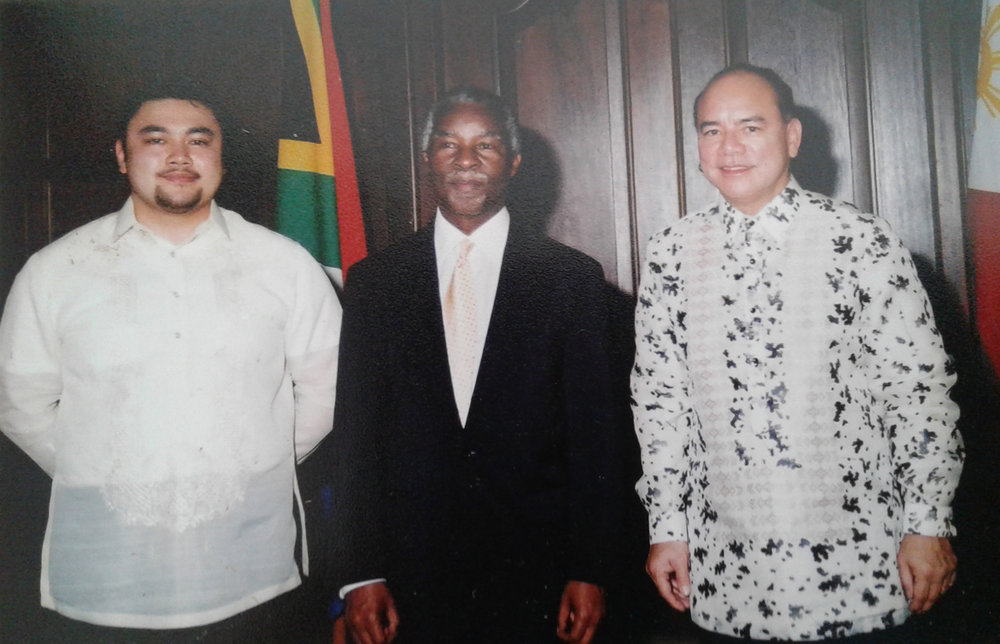 Ambassador Virgilio Reyes, Jr. with son, Paul Philippe Reyes, at presentation of credentials to President Thabo Mbeki, South Africa,  2003 (Photo courtesy of Ambassador Virgilio Reyes, Jr.)
