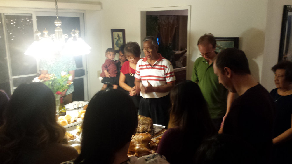 Mr. Palmares saying a blessing over our family during a gathering (Photo courtesy of Jen Palmares-Meadows)