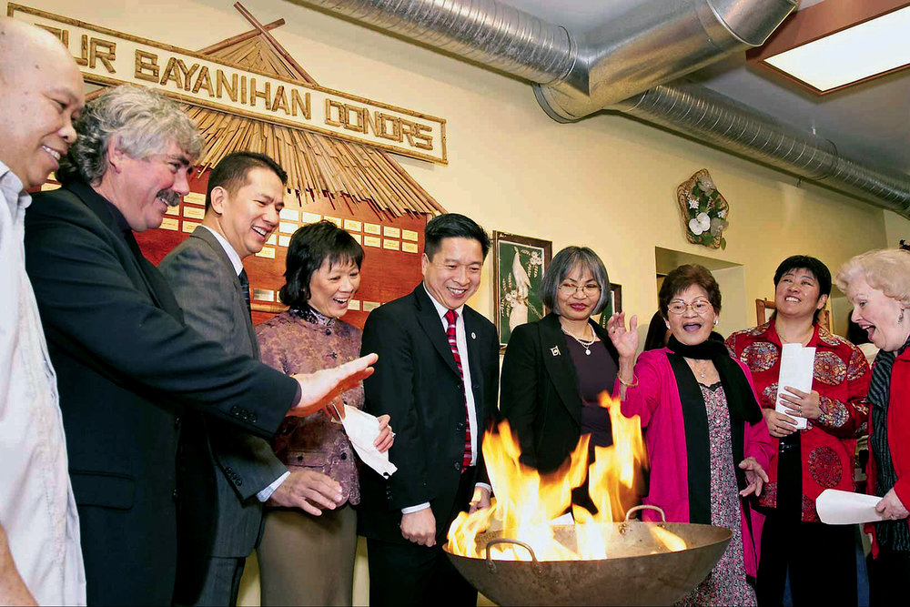 A mortgage-burning ceremony, after a $250,000 was paid down in just five years, was held at the Bayanihan Community Centre on January 28, 2007, with dignitaries attending.  They included Victoria Hillside Member of the Legislature Steve Orcherton [second from left], acting Philippines' Vancouver Consul General Raul Hernandez [third], provincial Community Services Minister Ida Chong [fourth], Victoria Mayor Alan Lowe [fifth], and Victoria City Councillors Charlayne Thornton-Joe and Helen Hughes [seventh and eighth].