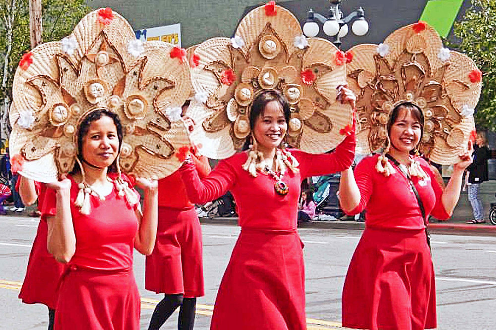 Canadians of Filipino ancestry dance along the route during the annual Victoria Day Parade in May.  Members of the Victoria Filipino Canadian Association, the Victoria Filipino Canadian Seniors Association, the Victoria Filipino Canadian Caregivers Association and the Bayanihan Cultural and Housing Society have participated in the parade for decades under one banner.  The first participation was in 1972 and in 1998, the 100th anniversary of Philippine declaration of independence, the Victoria Filipino Canadian Association had more than 120 individuals in the award-winning Kalayaan '98 tableau showcasing five eras of Philippine history.