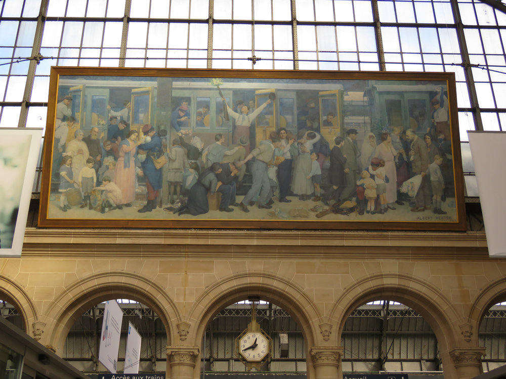 The mural in the Gare de l'est (train station). It's a mural depicting soldiers leaving to the front, their families sending them off, from the station, most likely soldiers fighting in the front lines in the Ardennes region. (Photo by Criselda Yabes)